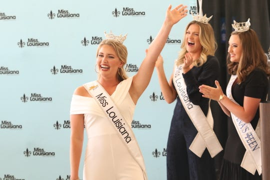 Miss Louisiana 2020 Courtney Hammons takes her first walk with the crown on Tuesday in Monroe, Louisiana. She's cheered on by Miss Louisiana 2019 Meagan Crews and Miss Louisiana Outstanding Teen 2020 and 2021 Chanley Patterson.