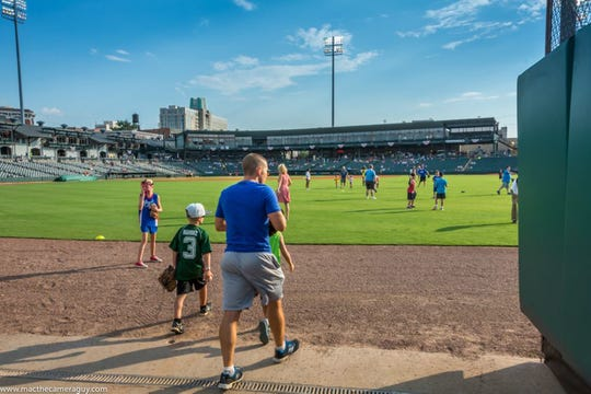 Guests can play catch on the field Saturday at Riverwalk Stadium, the home of the Montgomery Biscuits.
