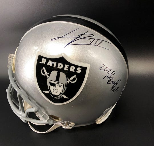 Henry Ruggs autographed Raiders helmet With 2020 1st Round Pick inscription was sold at Auction Tuesday night.