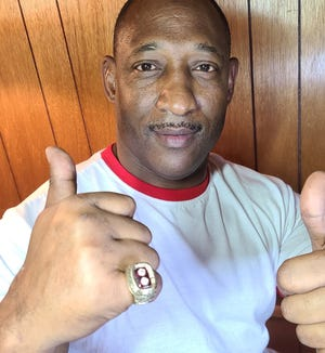 Former Oakland running back James Howse, who went on to play at Texas A&M, shows off his Cotton Bowl ring that was returned to him last weekend after being missing for more than 30 years.