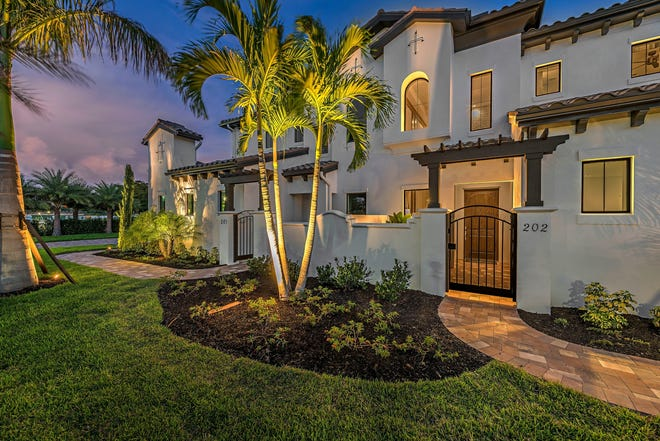 Talis Park's Corsica coach homes offer 2,550- and 3,400-square-feet of living space and fairway, water and garden views. A designer-furnished model is open daily.