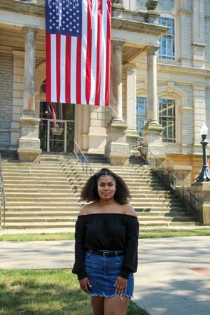 Newark High School Junior Carmen Lewandowski poses for a portrait near the Licking County Courthouse in Newark on Tuesday, June 16, 2020. Lewandowski is organizing a candlelight vigil in remembrance of Black lives who have been abused or oppressed on Friday on the Newark Square.