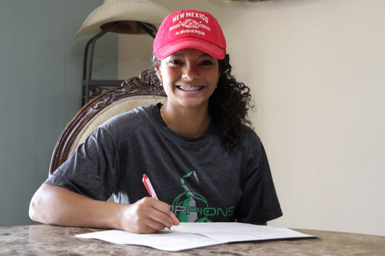 Farmington's Kiara Quezada signs her National Letter of Intent on Tuesday, June 16, 2020, to continue her track and field career at NCAA Division I University of New Mexico in Albuquerque.