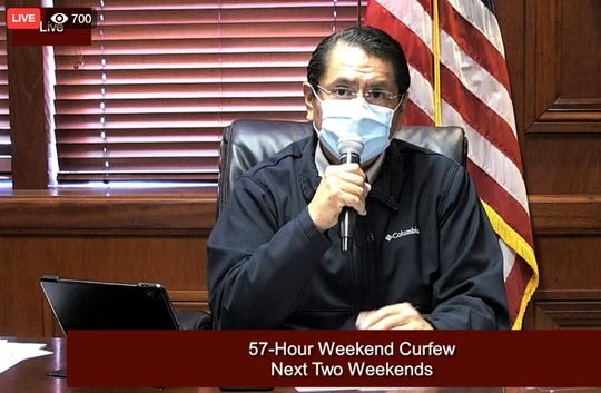 A screenshot shows Navajo Nation President Jonathan Nez talking about the reinstated weekend curfew during a town hall meeting on June 16 on Facebook.