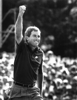 Curtis Strange raises his fist in triumph as he approaches the 18th green in the final round of the 1989 U.S. Open.