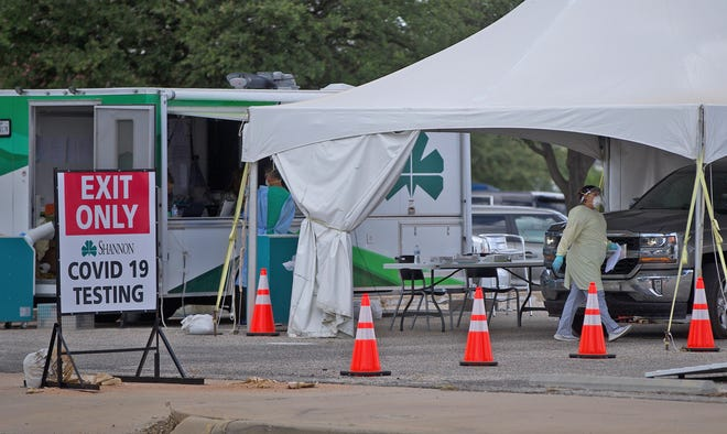 Staff at Shannon Medical Center conduct coronavirus testing at a drive through site Tuesday, June 16, 2020.