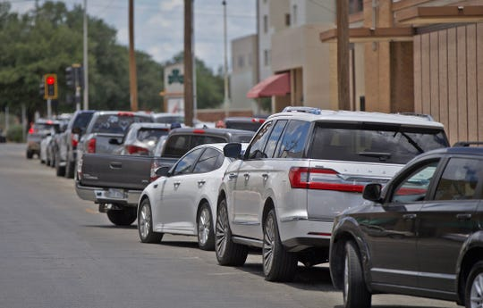 A line of cars wait to get into the drive through coronavirus testing site at Shannon Medical Center on Tuesday, June 16, 2020.