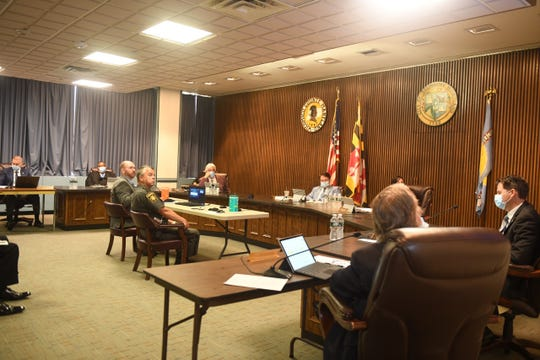 Wicomico County Sheriff Mike Lewis and Deputy State's Attorney Bill McDermott speak to Wicomico County Council on June 16, 2020.