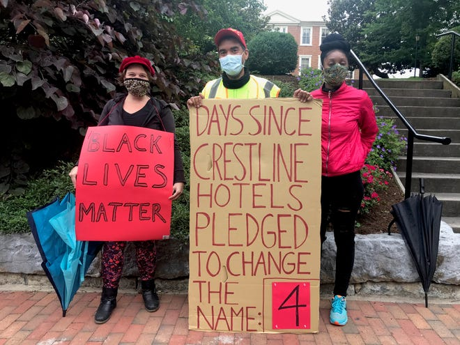 On Tuesday, June 16, 2020, Arrow Kilbourn, Aaron Barmer and Jazmine Brooks stand outside the Stonewall Jackson Hotel & Conference Center in Staunton, Virginia, to hold the hotel owners accountable in their pledge to change the name.