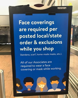 Standing signs instructing customers to wear face coverings while shopping in Walmart are placed in multiple areas at the entrance to the superstore in Staunton. Photograph taken on Friday, June 12, 2020.