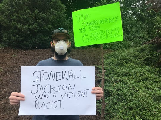 A group of citizens vow to stand outside Stonewall Jackson Hotel & Conference Center in Staunton, Virginia, every day until the hotel changes its name. Photograph taken of Joshua Rose on Tuesday, June 16, 2020.