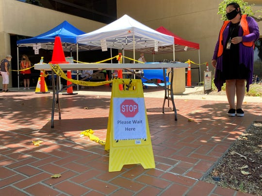 Tented outdoor tables and court workers in masks greeted the public outside Ventura County Superior Court on June 15, 2020, when the court reopened with modified operations due to the coronavirus.