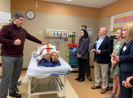 In 2018, Dr. Michael Meyer introduces members of the Dairy Cares of Wisconsin organizing committee to the simulation lab at Children's Wisconsin, based in Milwaukee. The hands-on training in the lab allows the next generation of health care providers to safely practice for a variety of emergencies in multi-faceted educational space.
