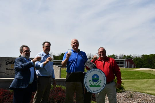 Raising a milk toast with EPA Administrator Andrew Wheeler, left, during a tour at Golden E Dairy Farms in West Bend on June 15, 2020, was EPA Region 5 Administrator Kurt Thiede, DBA President Tom Crave, second from right, and WFBF President Joe Bragger, right.