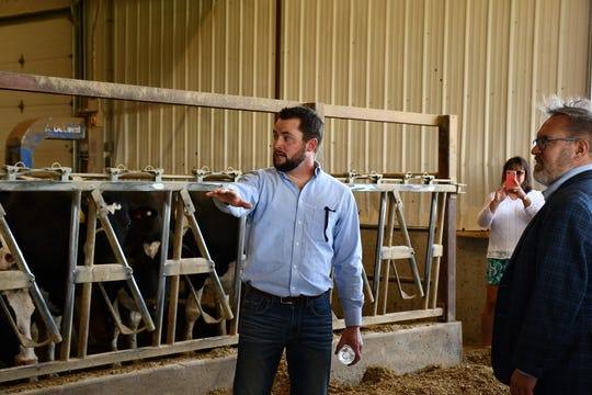 Golden E Dairy farm founder Ryan Elbe gives EPA Administrator Andrew Wheeler a tour of the family's 2400-cow dairy on June 15. The farm produces fluid milk to Dairy Farmers of America and employs several conservation measures.