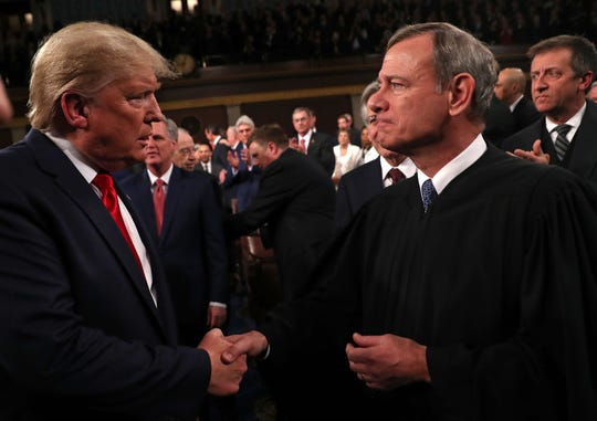 Chief Justice John Roberts greeting President Donald Trump at this year's State of the Union address.
