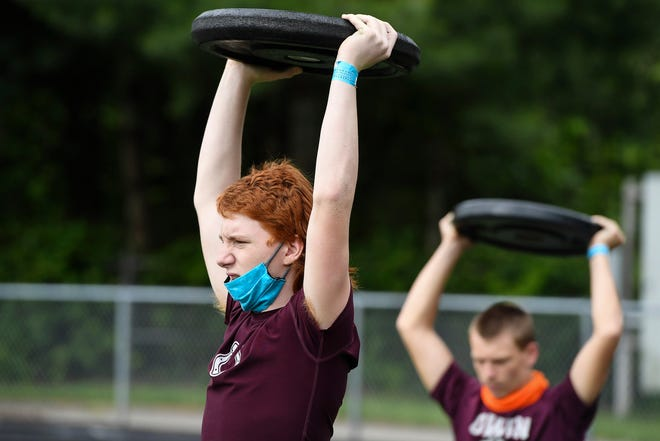 Owen junior Zeke Grabowski lifts a weight over his head during football practice June 17, 2020.