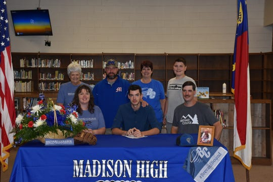 Madison High School graduate Timothy Wilson, seated in the center, signed to play baseball with Brevard College joined by his parents Beth and Dwayne Wilson Jr., (seated), great-grandmother Jan Franklin, coach Ronald Tipton, grandmother Cathy Brackins and brother Brayden.