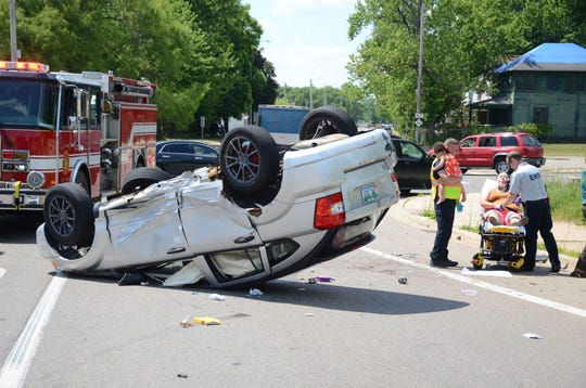 One woman was injured in this rollover crash Tuesday.  Trace Christenson/The Enquirer