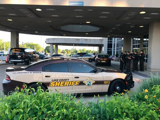 Lake County Sheriff's squad cars are parked outside of Community Hospital in Munster, Ind., Tuesday, June 16, 2020, as a fatal shooting investigation is conducted. A psychiatric patient disarmed and fatally shot a retired police officer at the northwest Indiana hospital early Tuesday before another retired officer working security at the hospital fatally shot the patient, a sheriff said.