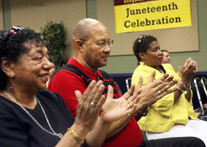 Pat Taylor (left to right), Lamont Taylor, and Gloria Smith applaud the performance of vocalist and Del Mar College student, Jessica Davis, who sang 'Lift Every Voice and Sing' during the Juneteenth Celebration at the Harvin Student Center at Del Mar College on June 12, 2009.