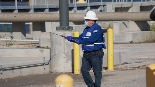 Rick Diaz de leon, HSE Specialist at Pin Oak Terminals, acts as a safety personnel to monitor reaction to the safety plan and document response at a fire simulation on June 17.