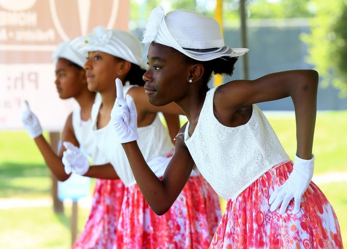 Dancers from Saint John's Baptist Church perform during the Juneteenth Celebration Saturday June 13, 2015 at South Bluff Park in Corpus Christi.