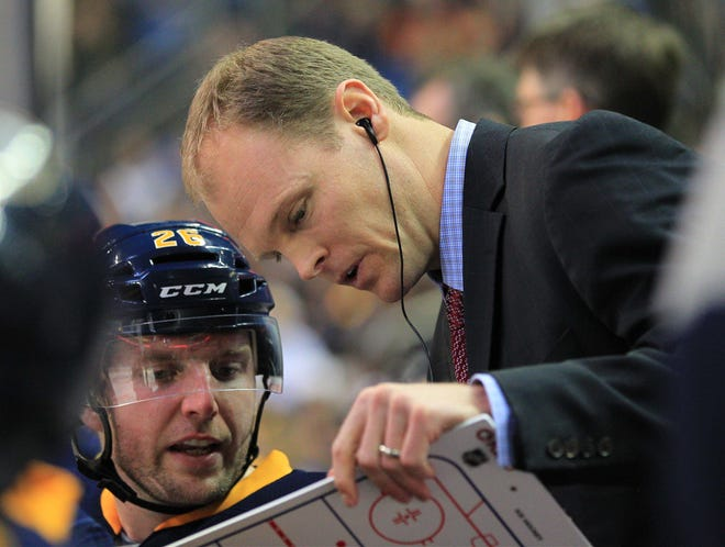 Buffalo Sabres assistant coach Kevyn Adams talks to left wing Thomas Vanek (26) on the bench during the game against the New York Islanders at the First Niagara Center in February 2013.