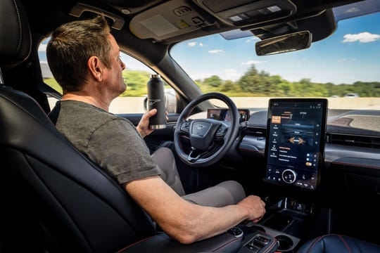 """John Gilchrist, a Ford Mustang Mach-E engineer, shows  hands-free technology known as """"active driver assist"""" that will become availalbe to consumers in the second half of 2021."""