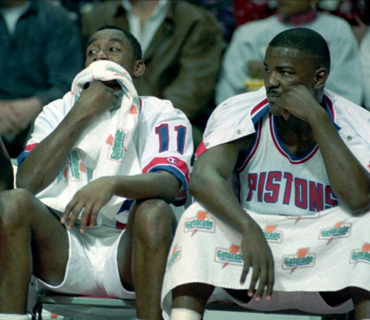 Pistons guards Isiah Thomas, left, and Joe Dumars sit on the bench midway through the first quarter watching the Utah Jazz increase their lead on Jan. 17, 1994, at the Palace of Auburn Hills.