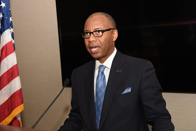Kenneth Kelly, CEO of First Independence Bank, addresses an audience of banking, community and business leaders at the Detroit Athletic Club on February 27, 2019.
