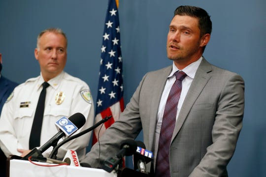 St. Charles County Prosecuting Attorney Tim Lohmar, right, speaks alongside Florissant Police Chief Timothy Fagan during a news conference Wednesday, June 17, 2020, in O'Fallon, Mo.