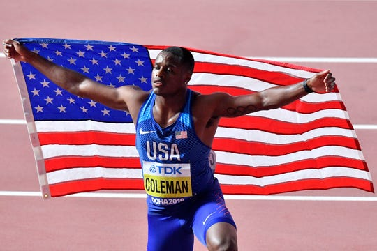 n this Sept. 28, 2019, file photo, Christian Coleman, of the United States, poses after winning the men's 100 meter race during the World Athletics Championships in Doha, Qatar.