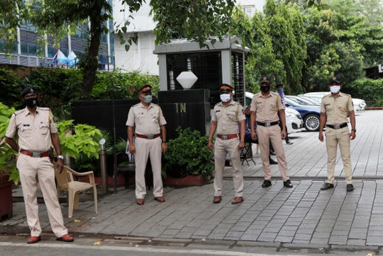 Indian policemen guard outside Chinese consulate anticipating protests in Mumbai, India, Wednesday.