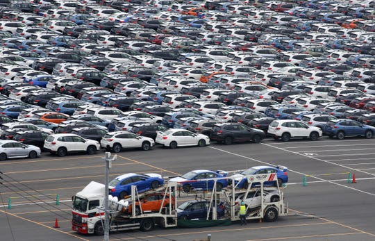 This July 8, 2019, file photo, shows cars to be exported at Kawasaki port, near of Tokyo. Japan's exports sank 28% in May, 2020, while imports dropped 26% as the coronavirus pandemic slammed global trade.