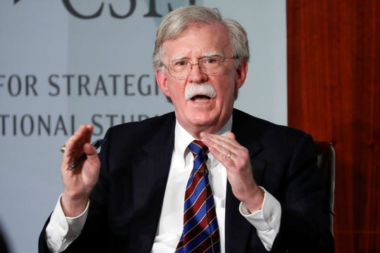 In this Sept. 30, 2019, file photo, former national security adviser John Bolton gestures while speakings at the Center for Strategic and International Studies in Washington.