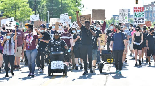 Protesters march against police brutality on Michigan Avenue in Detroit on June 17, 2020.  This is the 20th day of protests in Detroit.