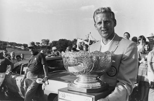 Larry Zeigler holds the trophy after winning the Michigan Golf Classic in 1969.