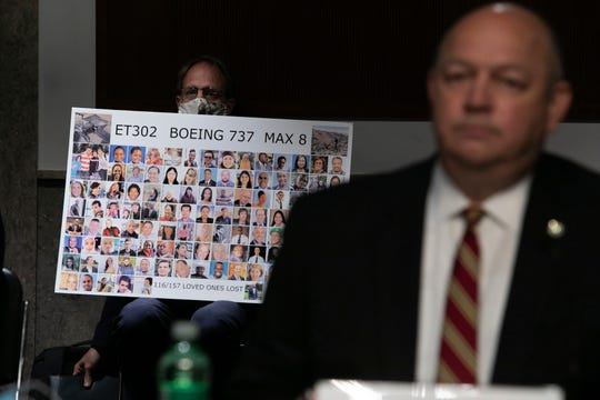 Michael Stumo holds a sign displaying photographs of the individuals who were killed in the March 10, 2019, crash of Ethiopian Airlines flight 302, as Federal Aviation Administration administrator Stephen Dickson testifies during a hearing of the Senate Commerce, Science, and Transportation Committee on Capitol Hill on Wednesday, June 17, 2020, in Washington.