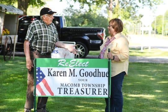 Macomb Township Treasurer Karen Goodhue with supporter Don Schwark where she posted a campaign sign in Macomb Township on June 17, 2020.
