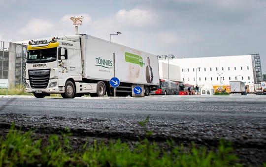 A truck leaves the Toennies meatpacking plant in Rheda-Wiedenbrueck, Germany, Wednesday, June 17, 2020.
