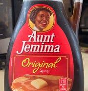 A bottle of Aunt Jemima syrup.