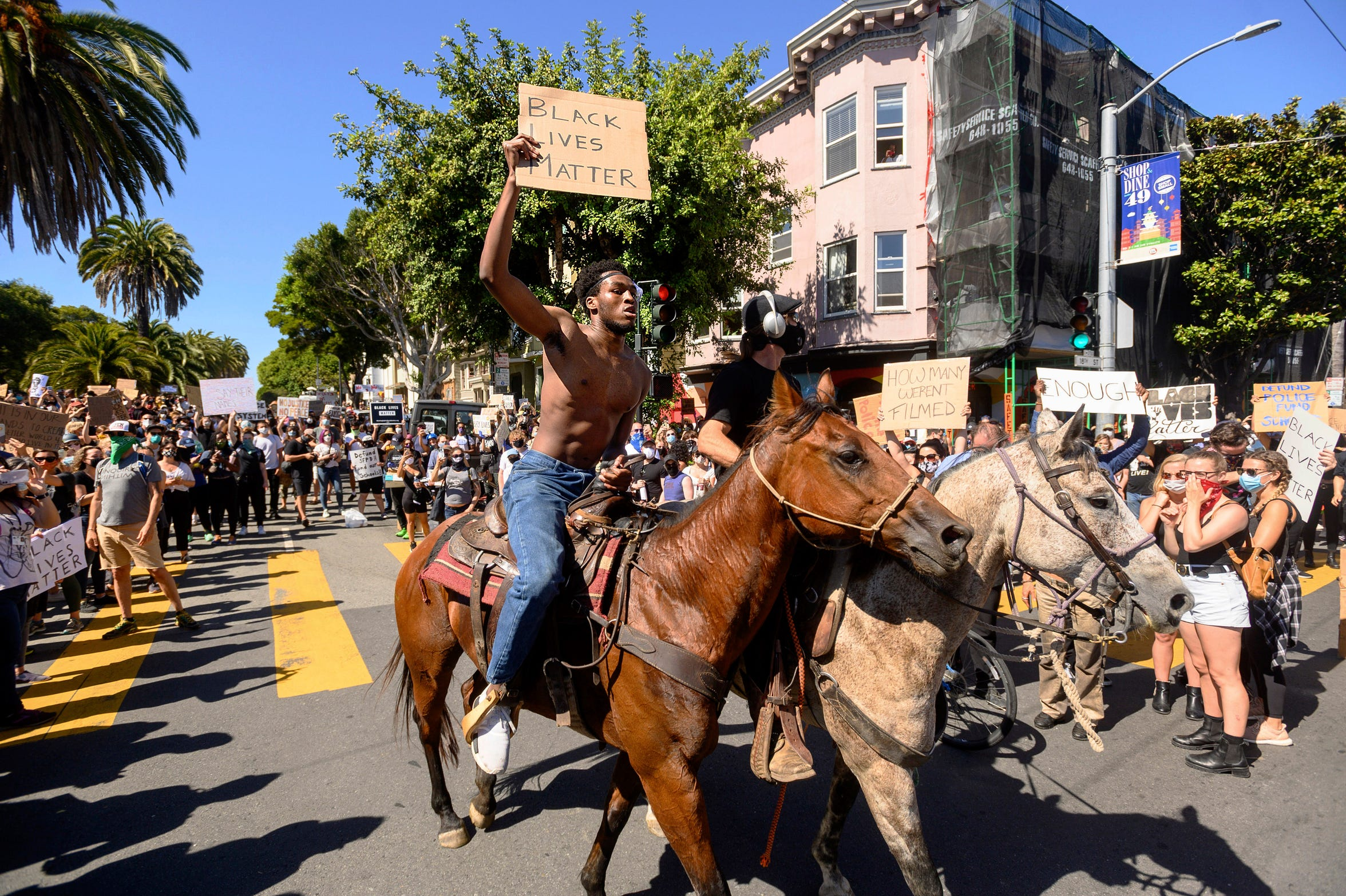 Chinedu Anigbogu rides a horse with demonstrators in a rally in San Francisco's Mission District on Wednesday, June 3, 2020, to protest the death of George Floyd, who died after being restrained by Minneapolis police officers on May 25.