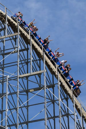 """People ride a wooden rollercoaster called """"The Voyage"""" at Holiday World & Splashin' Safari in Santa Claus, Ind., Wednesday morning, June 17, 2020."""