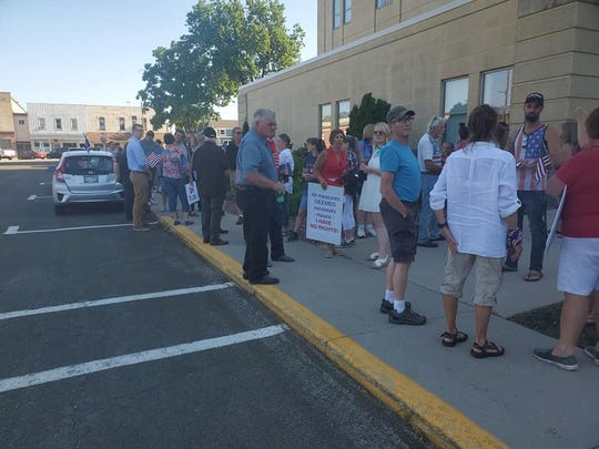 More than 250 people peacefully assembled Tuesday at the Dodge County Administrative Building in Juneau to share their views on a health-related ordinance up for discussion by the county board.