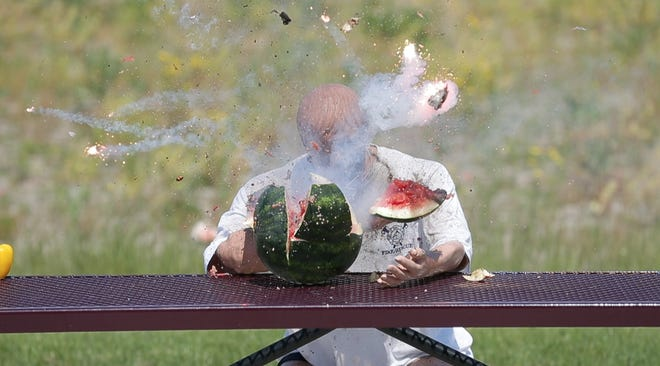 A watermelon breaks apart after a firework explodes inside it Wednesday, June 17, 2020 during a display by the Fond du Lac Fire/Rescue Department, showing the dangers fireworks pose to people. Doug Raflik/USA TODAY NETWORK-Wisconsin