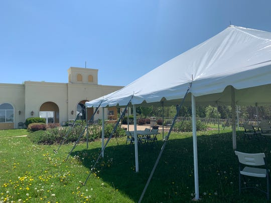 A large tent outdoors with tables spaced far enough apart at Parallel 44 Winery in Kewaunee is expected to see increased use this summer to help customers practice social distancing.