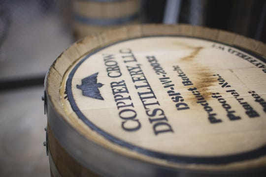 Spirits are aged in barrels on-site at the Copper Crow Distillery in the Northwoods.