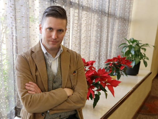 "FILE – In this Dec. 6, 2016, file photo, white nationalist Richard Spencer poses between interviews in College Station, Texas. A judge in Montana has told  Spencer that he faces two weeks in a county jail if he doesn't reach a plan this week to pay off a legal debt stemming from his divorce case, according to court records. On Wednesday, June 17, 2020 Spencer said ""I have every confidence that we will reach an agreement and this will be quickly forgotten and under the bridge"". (AP Photo/David J. Phillip, File)"