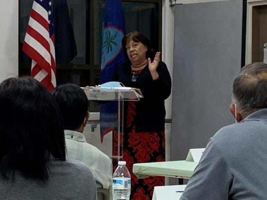 Carlotta Leon Guerrero, the governor's chief adviser for military and regional affairs, discusses the Compacts of Free Association with village mayors Wednesday at the Dededo senior citizen's center.